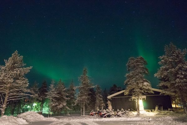 Seeing the Northern Lights just outside our lodge on the first night
